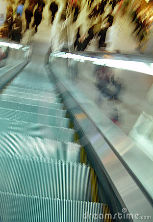 Escalator and blurry crowd movement