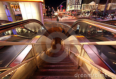 Escalator and Staircase Down with Blurred Traffic and Lights Editorial Stock Image