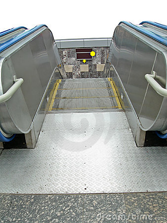 Escalator to underground metro station, city