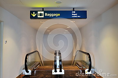 Escalators leading to baggage collection area