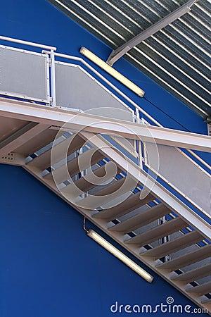 Escher stairs over blue wall