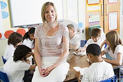 ESchoolchildren and their tacher reading in class