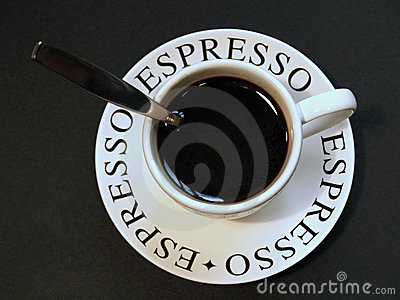 Espresso coffee in cup with spoon