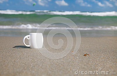 Espresso coffee in white cup with ocean