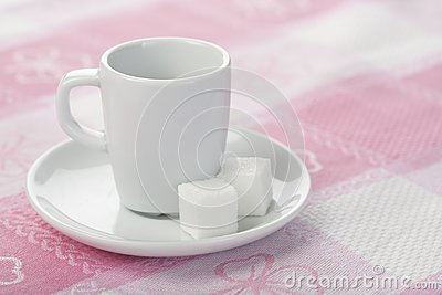 Espresso cup on tablecloth