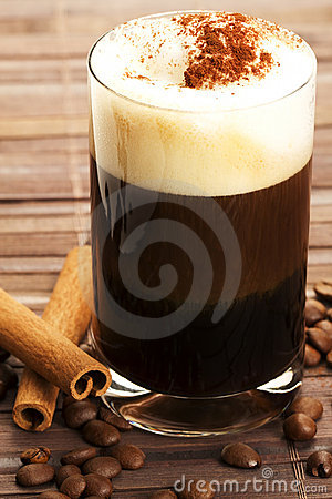Espresso with milk froth cocoa powder and cinnamon