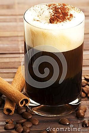 Espresso with milk froth cocoa powder and cinnamon
