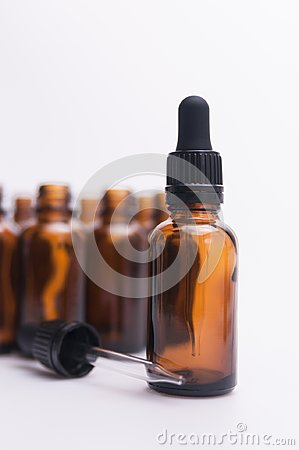 Free Essential Oil Glass Bottle With Dropper And Bottles In Background Stock Photography - 109338662
