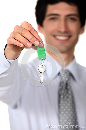Estate agent with a key