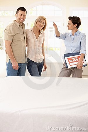 Estate agent showing around couple
