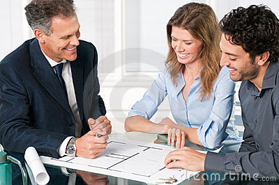 Estate agent with smiling couple