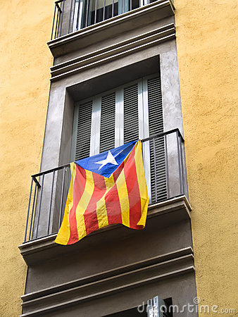 Estelada flag hanging from a balconade