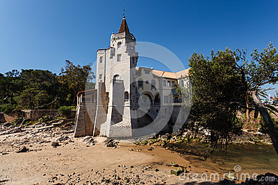 Estoril, Portugal beach with beautiful luxury home with castle tower