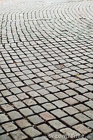 Estrada áspera do pavimento do Cobblestone