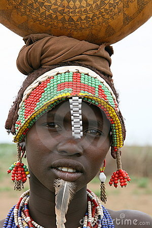 Ethiopian woman carrying goods on head Editorial Image