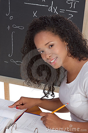 Ethnic black college student studying math exam