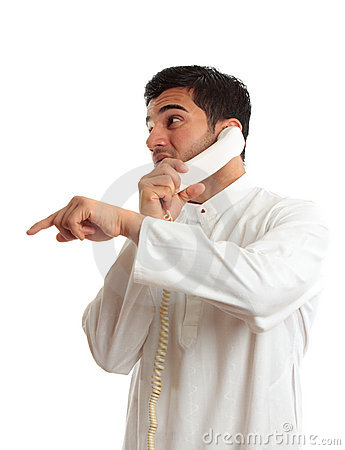 Ethnic Businessman On Phone Pointing