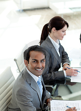 Ethnic businessman smiling at the camera
