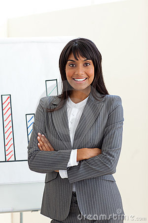 Ethnic businesswoman with folded arms