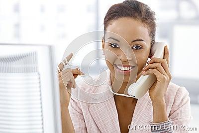 Ethnic businesswoman on landline call