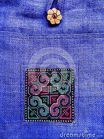 Ethnic cross stitch pattern on bag