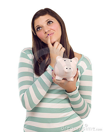 Ethnic Female Daydreaming While Holding Piggy Bank