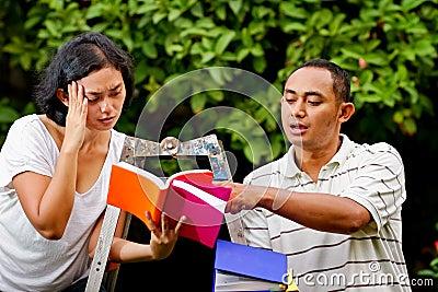 Ethnic friends discussing literature