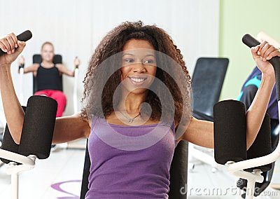 Ethnic girl exercising at the gym