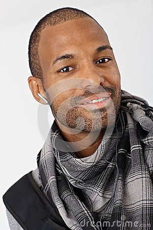 Ethnic guy smiling with earbuds