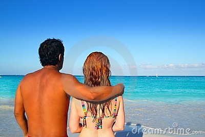Ethnic mixed couple man woman beach vacation