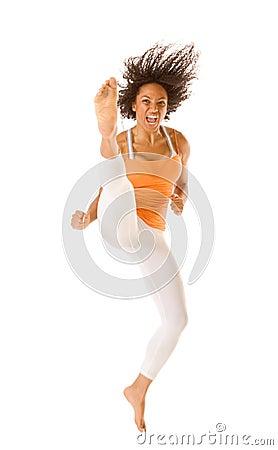 Free Ethnic Sports Karate Woman Jumping And Kicking Royalty Free Stock Photo - 4670775