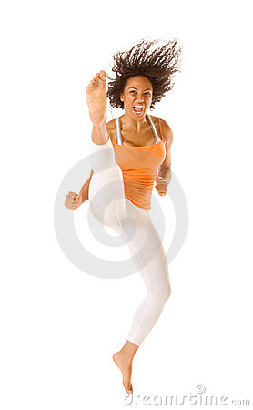 ethnic sports karate woman jumping and kicking