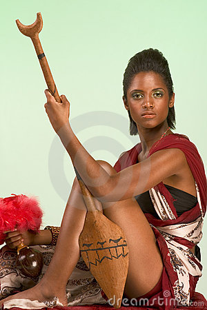 Ethnic woman chief with spear and other artifacts
