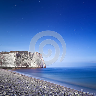 Etretat Aval cliff landmark and its beach. Night photography. Normandy, France.