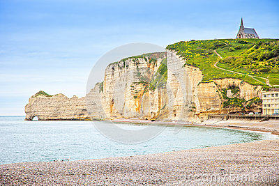 Etretat cliff, church landmark and beach on morning. Normandy, F