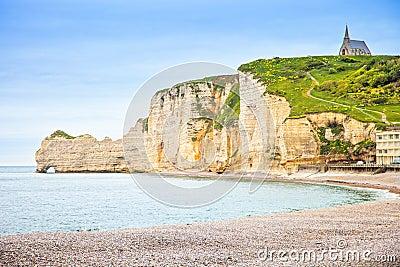 Etretat cliff, church landmark and beach on morning. Normandy, F