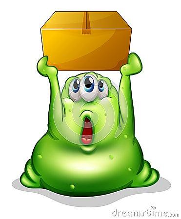 Ett grönt monster som bär en ask