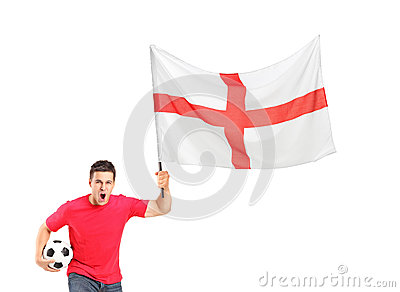 Euphoric fan holding a ball and English flag