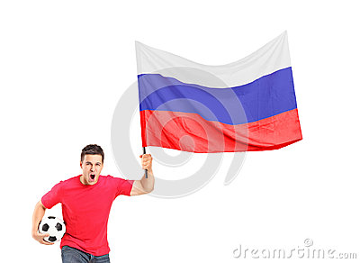 An euphoric fan holding a ball and a russian flag