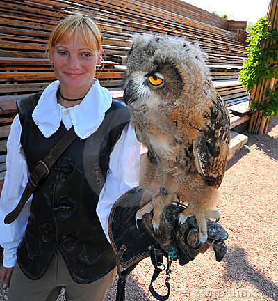Eurasian eagle owl with trainer Editorial Photo