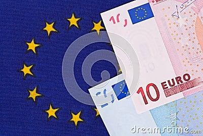 Euro banknotes on a European Union flag