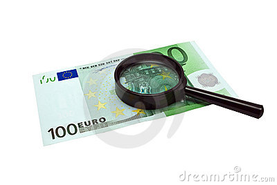 Euro banknotes money and magnifying glass