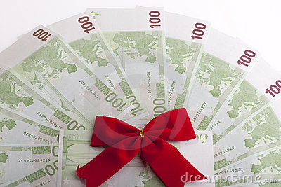 Euro banknotes with red ribbon