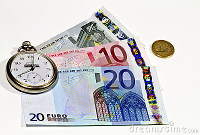 Euro banknotes and watch