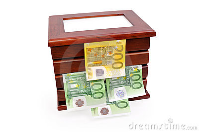 Euro banknotes in a wooden casket