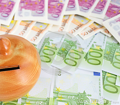 Euro bills and moneybox