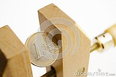Euro coin under pressure