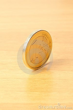 Euro coin on wood