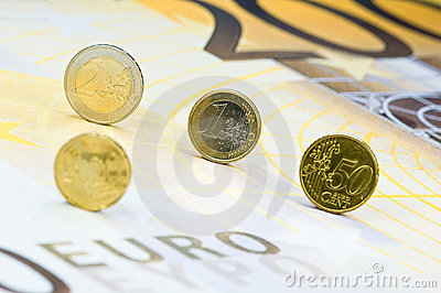 Euro coins on banknote