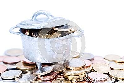 Euro coins in cauldron